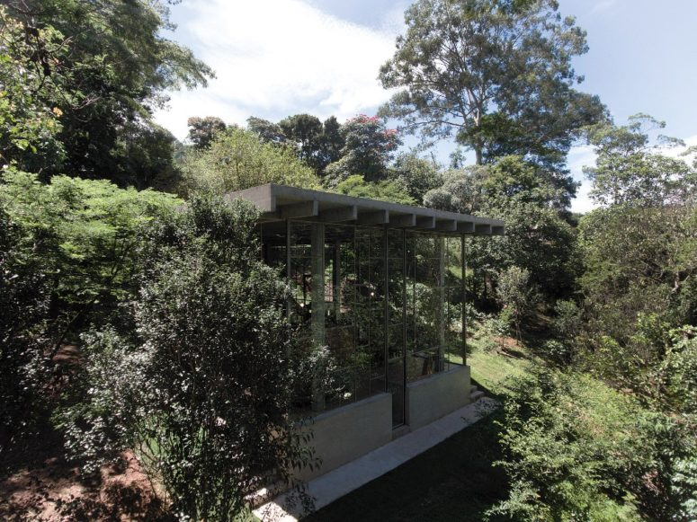 The house is built into a slope and looks totally harmonious there, glass walls allow enjoying the views