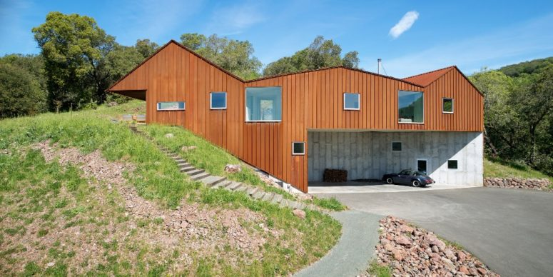 The house is built into a steep slope and looks natural in the surroundings