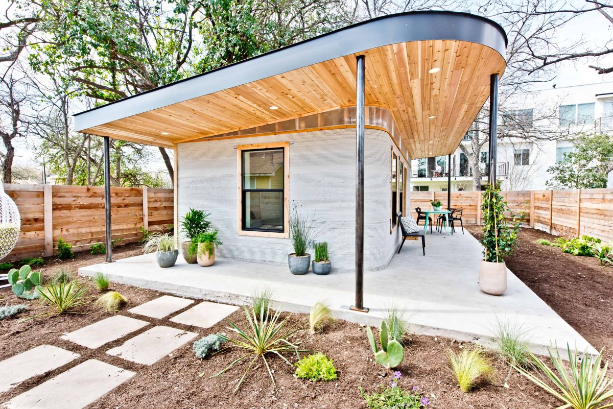 The house is built of cement and plywood, the base is 3D printed and all the rest is installed manually