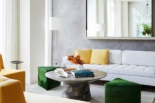 02 The living room is done with yellow and green touches and geometric shapes plus a statement mirror
