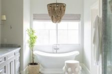 02 a gorgeous glam bathroom chandelier that differs in color and makes a statement in the space with its wow look