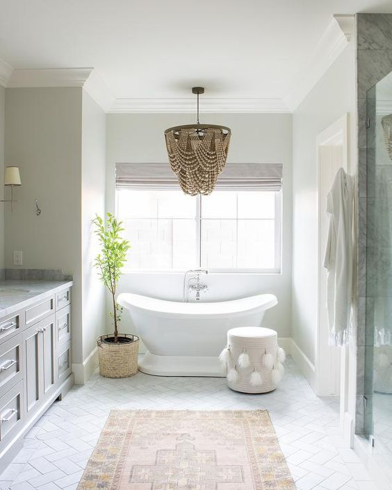 a gorgeous glam bathroom chandelier that differs in color and makes a statement in the space with its wow look