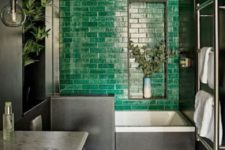 02 a moody bathroom with a statement emerald tile wall, a checked floor and a marble countertop looks super bold