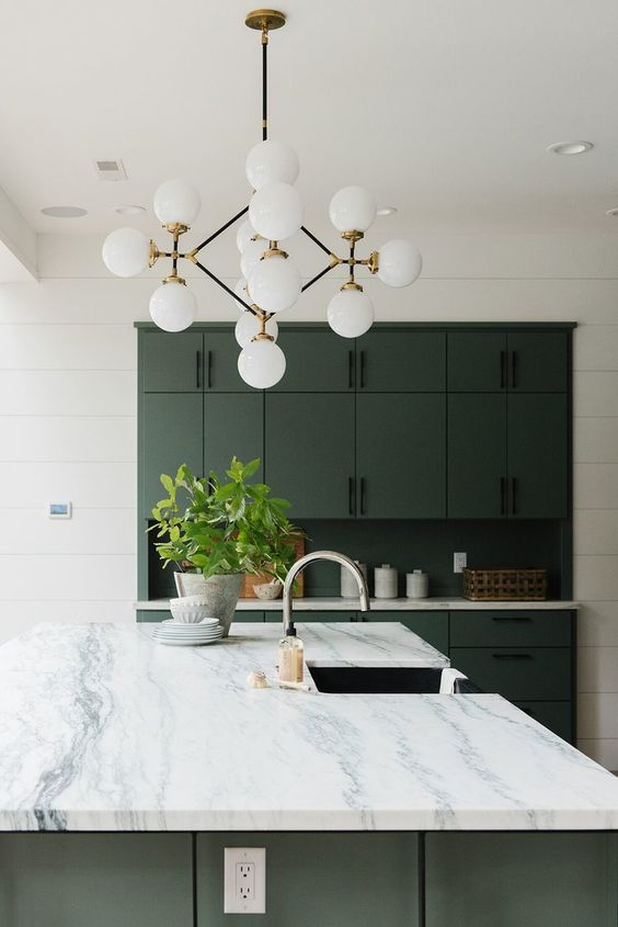 a statement mid-century modern bubble chandelier is a cool idea to add timeless elegance and much light to the kitchen