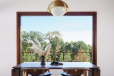 03 The dining space is done with a folding table and stylish leather chairs and is located next to the window to maximize the light and views