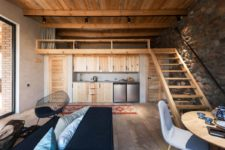 03 The interiors are simple and cozy, which is dictated by the choice of materials, and the color scheme is earthy and natural