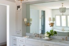 03 a beautiful brass and mother-of-pearl chandelier for making a statement in a traditional bathroom