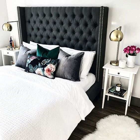 a black tall diamond upholstery headboard with nail trim is a bold and chic statement with a touch of drama