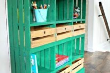 03 a bright emerald shelving unit built of crates and a wooden tabletop for a kids' space