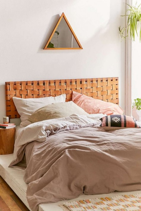 a woven leather headboard in a pretty bold amber shade is ideal for a boho or woodland bedroom