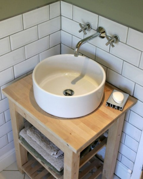 an Ikea Bekvam kitchen cart and Tornviken countertop sink turned into a chic rustic vanity with a bowl sink