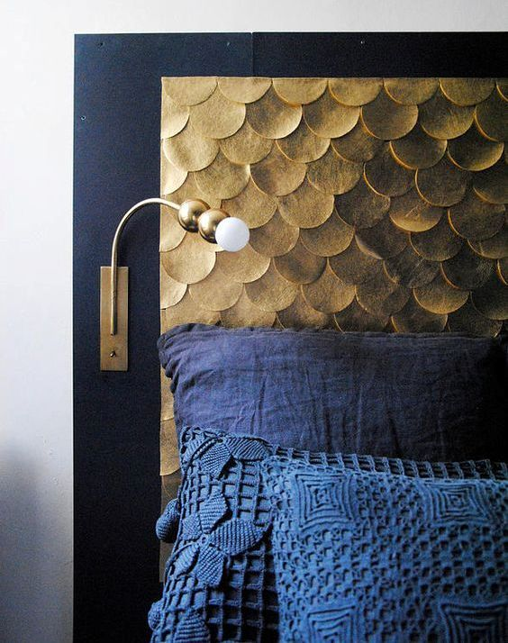 an elegant headboard with a black frame and gold scallops will bring much color and texture to the space