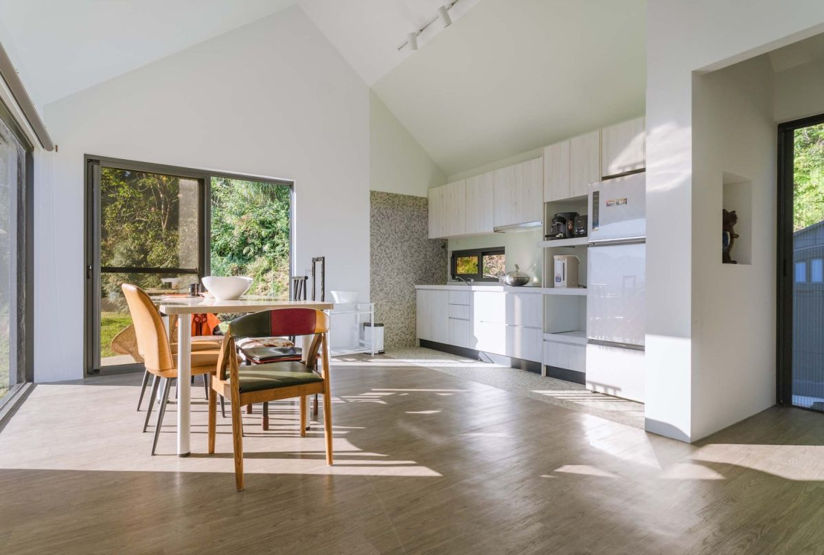 The inner space is a large open layout filled with light and done in neutral colors to make it look bigger