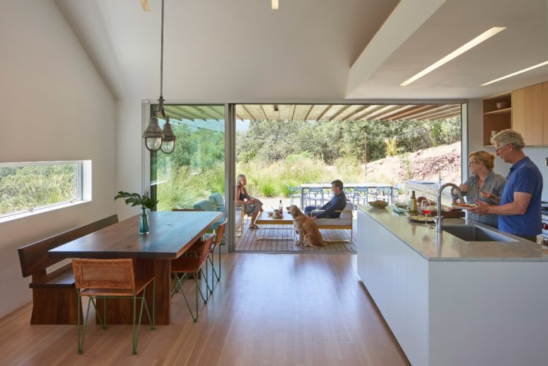 The kitchen is the heart of the house, and there's a dining space here, with is located next to a window