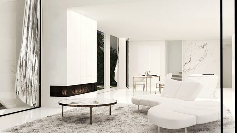 The living room is done with white marble, sleek white panels and stylish and simple furniture