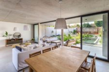 04 The main space is open plan, with a kitchen, dining room and living room, and it's extended outdoors – to a terrace with a pool