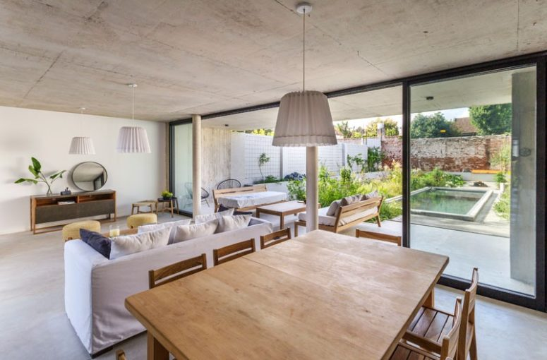 The main space is open plan, with a kitchen, dining room and living room, and it's extended outdoors - to a terrace with a pool