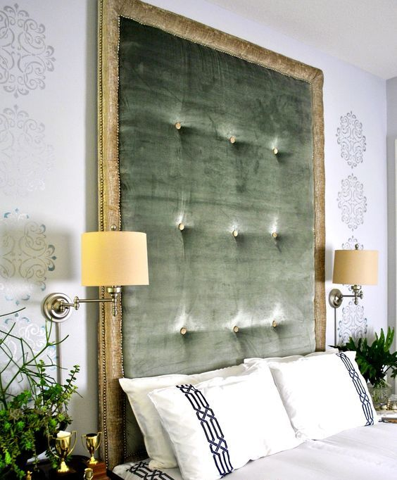 a statement green tufted headboard with gold framing is a stylish idea with a refined feel