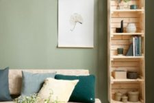04 a tall shelving unit of crates and vintage legs naturally fits a mid-century modern living room easily