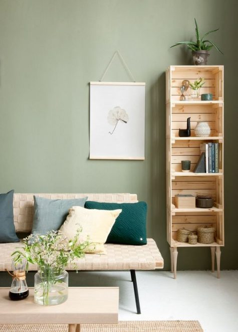 a tall shelving unit of crates and vintage legs naturally fits a mid-century modern living room easily