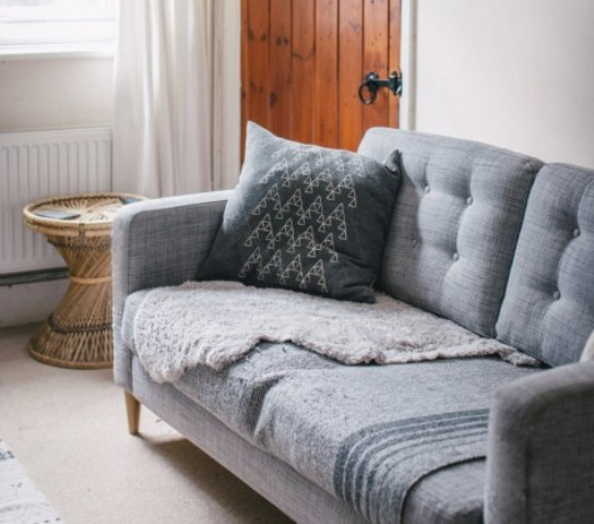 an IKEA Karlstad hack with tufting and mid-century legs is a chic and timeless idea to go for