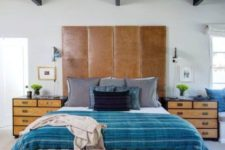 04 an eclectic space with a tall brown leather headboard for a textural touch