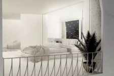 05 The bedroom is very dreamy and I like how lights are placed here, there's a minimalist platform bed and a potted plant