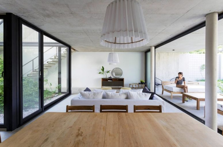 The color scheme is all neutral, creamy, white, tan and light and dark stained wood to make the spaces lively