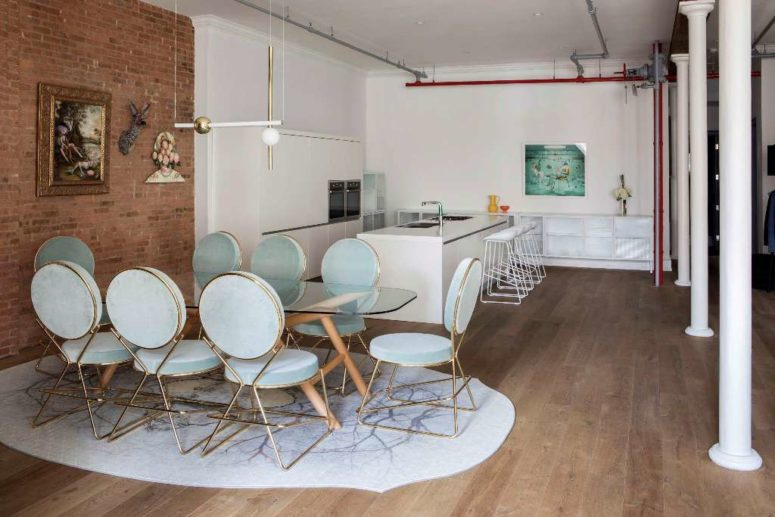 The kitchen is minimalist and is done in white not to distract attention from the bold dining zone