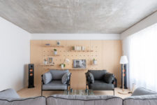 a pegboard wall is a practical storage-display solution for a living room