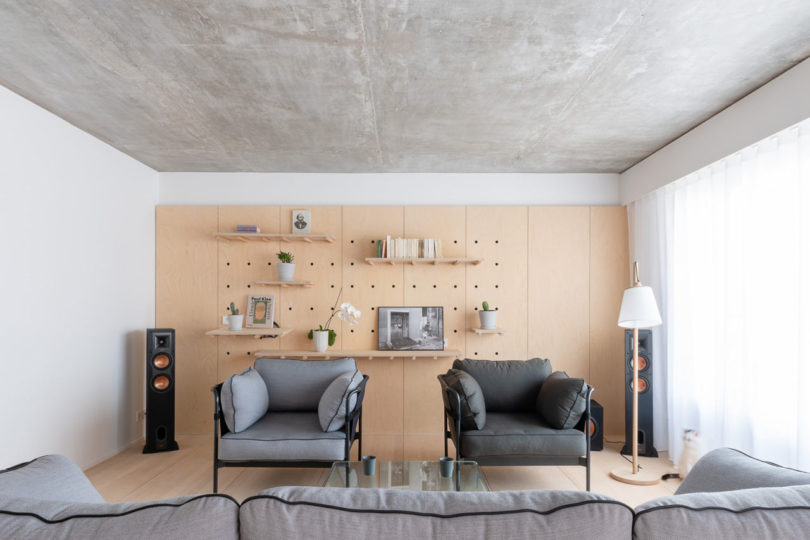 a pegboard wall is a practical storage display solution for a living room