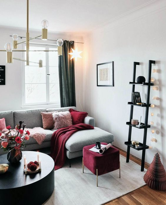 a glam chandelier, a garland of lights and a bold star-shaped hanging lamp for illuminating the space