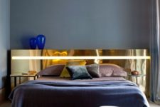 05 a unique and statement-like polished gold headboard is a refined and glam touch to the bedroom decor