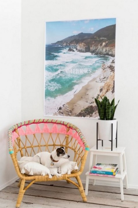 an IKEA Rattan chair hacked with colorful yarn and tassels for a boho feel - ideal for both indoors and outdoors