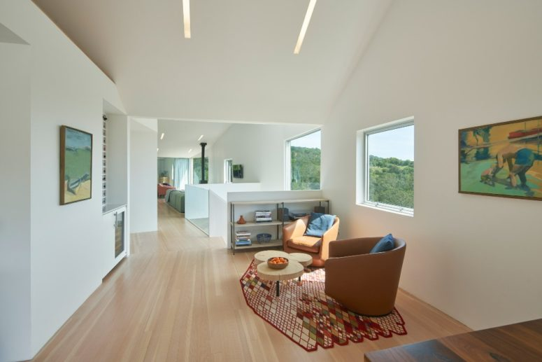 The interior plan is open and fluid and all the spaces are centered around the views