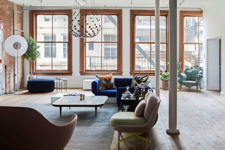 The main space is an open layout filled with light, greenery and eye-catchy furniture pieces