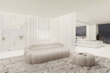 06 There's a lounge here, a sleek white marble kitchen and the spaces can be separated with a space divider for privacy