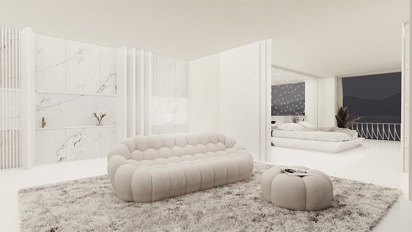 There's a lounge here, a sleek white marble kitchen and the spaces can be separated with a space divider for privacy