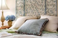 06 a creative and chic blue forged headboard will add a refined touch to the space