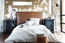 06 a sleek distressed leather headboard and a matching small ottoman bring color and texture to the room
