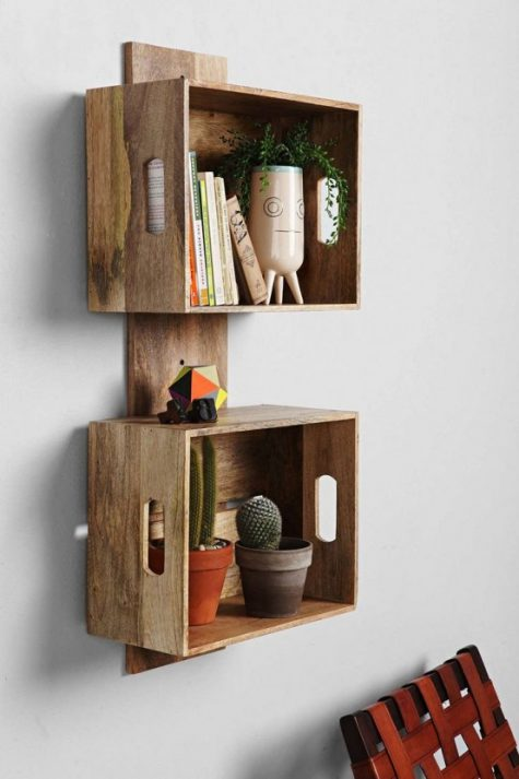 a stylish crate shelving unit of a wooden plank and crates will work for a rustic or mid-century modern space