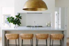 06 an oversized metal pendant lamp echoes with the rattan chairs and brings texture
