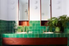 06 green tiles all over the bathroom contrast the rich stain of the wood and copper touches