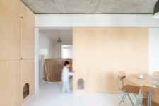 07 The color scheme is neutral, done with concrete, light-colored wood and touches of grey here and there
