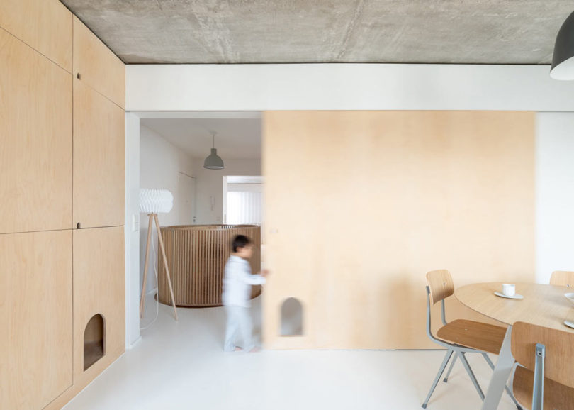 The color scheme is neutral, done with concrete, light colored wood and touches of grey here and there