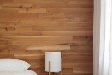 a stylish wood wall in a bedroom