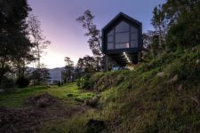 07 The minimalist house extends over the rugged terrain, overlooking the two valleys which frame it