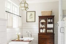 07 a chic faceted frosted glass chandelier over the tub is a beautiful and cool accent for a bathroom