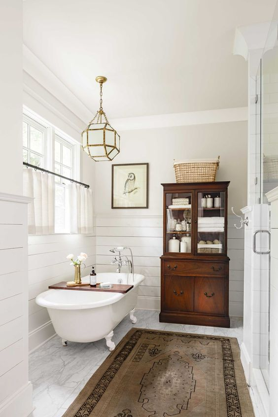 a chic faceted frosted glass chandelier over the tub is a beautiful and cool accent for a bathroom