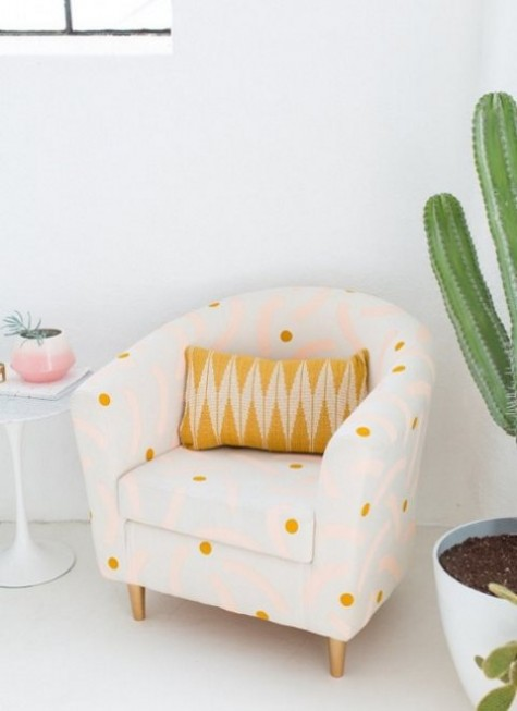 an IKEA Tullsta chair renovation with polka dot printed fabric and a bright pillow will add a cute feel to the space